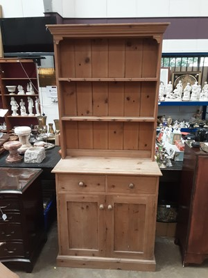 Lot 935 - Pine two height dresser with shelves above, two drawers and two panelled doors below, 90cm wide, 38cm deep, 199cm high