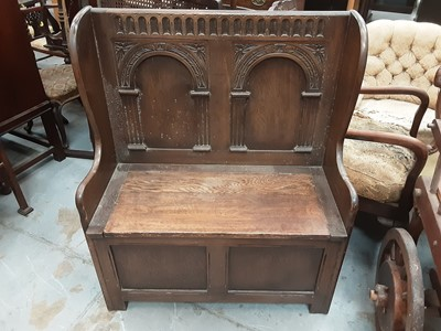 Lot 943 - Carved oak hall bench with carved panelled back and rising lid to seat, 86cm wide, 42cm deep, 103cm high