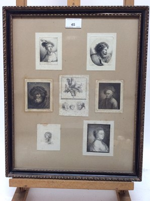 Lot 45 - Two framed displays of 18th century engravings after Rembrandt, Teniers and others, in glazed gilt and ebonised frames, 42cm x 34cm overall