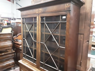 Lot 872 - Regcncy and later mahogany and oak two height bookcase, the upper earlier section enclosed by a pair of astragal glazed doors, the base enclosed by two panelled doors, 110cm wide x 35cm deep x 192c...