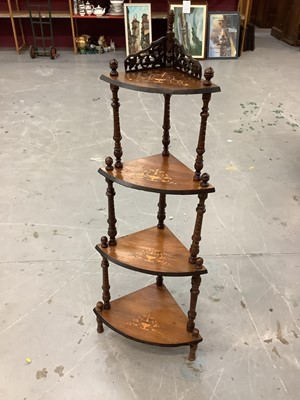 Lot 854 - Victorian inlaid figured walnut veneered four tier bow front whatnot with pierced fretwork and spiral fluted turned supports
