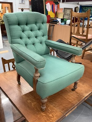Lot 851 - Victorian armchair upholstered in buttoned green material with turned beech legs on brass castors
