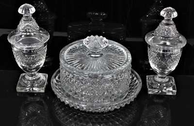 Lot 44 - Georgian cut glass butter tub and lid on stand, together with a pair of cut glass urns and covers