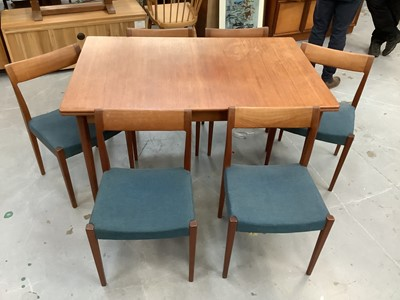 Lot 881 - A set of six 1960s Swedish teak Kontiki dining chairs and extending dining table, by Yngve Ekstrom for Troeds, the chairs with blue stuffover seats, on gently tapering supports, stamped marks verso