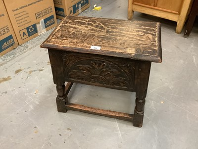 Lot 882 - Antique carved oak coffin stool with rising lid