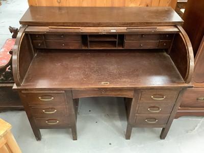 Lot 891 - Edwardian oak roll top desk