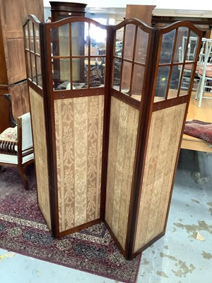 Lot 907 - Edwardian four-fold dressing screen and an Edwardian carved walnut cupboard enclosed by two carved panelled doors