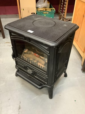 Lot 897 - Modern electric heater in the form of a wood burner