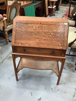 Lot 917 - Edwardian oak bureau with drawer on stand 73 cm wide and oak narrow bookcase 56 cm wide (2)