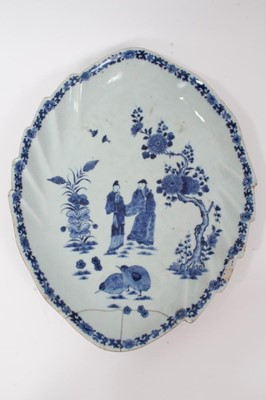 Lot 60 - Two 18th century Chinese blue and white leaf-shaped porcelain dishes, painted with figures