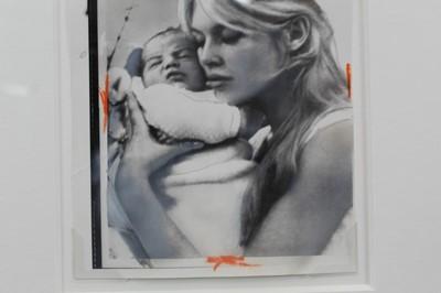 Lot 1852 - Vintage gelatin silver print - Bardot cuddles her two-day old son, Nicholas,  in glazed frame  Provenance: James Hyman Gallery