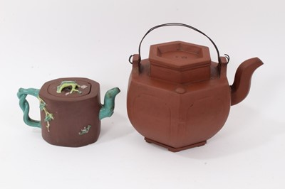 Lot 3 - Two Chinese Yixing teapots, 19th/20th century, the first of hexagonal form, seal marks to cover and base, 16cm high, the other with branch form handle and spout, enamelled in relief, 10cm high