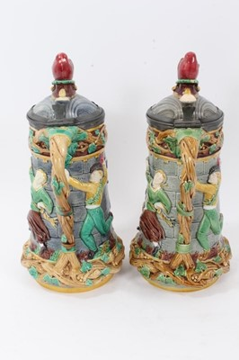 Lot 40 - A matched pair of Minton Majolica 'Tower' jugs, 1881 and 1883, 33cm height