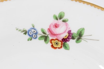 Lot 15 - Nantgarw plate, circa 1817-20, polychrome painted with flowers with gilt rim, impressed mark to base, 21cm diameter