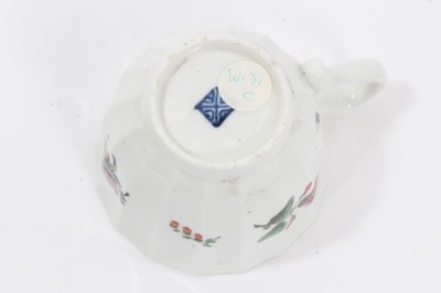 Lot 17 - Worcester faceted coffee cup and saucer, circa 1770, polychrome painted with flowers