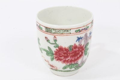 Lot 19 - Bow coffee cup, circa 1752, decorated in the famille rose style with flowers and a patterned border, 5.75cm high