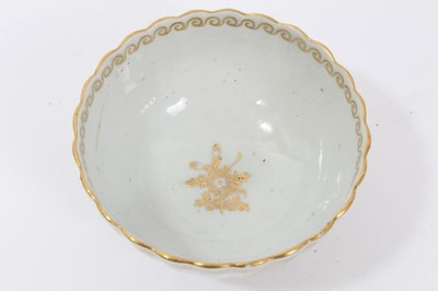Lot 20 - Worcester fluted tea bowl and saucer, circa 1775-80, decorated in gilt with swags and other patterns, the saucer measuring 14cm diameter