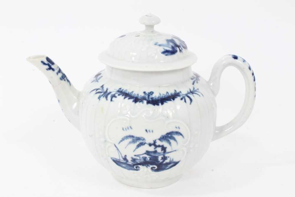 Lot 22 - Rare Worcester small strap-fluted teapot and cover, circa 1755, painted in blue with the Fisherman and Willow Pavilion pattern, workman's mark to base, 11cm high