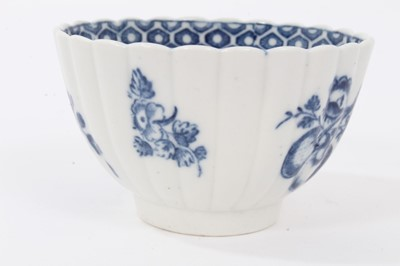 Lot 27 - Caughley tea bowl and saucer, circa 1780, of fluted form, printed in blue with the 'Apple' pattern, the saucer measuring 12.75cm diameter