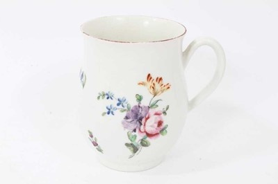 Lot 32 - Derby baluster shaped mug, circa 1760, polychrome painted with floral sprays, red painted rim, 10cm high