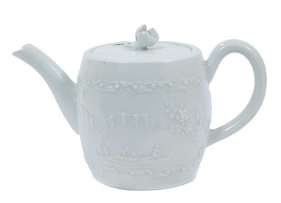 Lot 48 - Worcester white-glazed teapot, circa 1760, of barrel form, decorated in relief with a Chinese fishing scene on one side, and flowers verso, 18cm from spout to handle