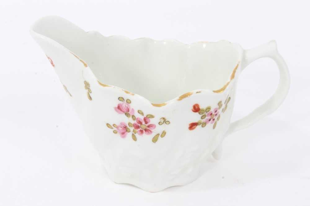 Lot 49 - Lowestoft ewer, circa 1790, of Low Chelsea form, polychrome painted with floral sprays, 5.75cm high