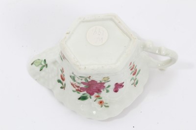 Lot 50 - Worcester cream boat, circa 1760, with hexagonal base, polychrome painted with flowers in the famille rose style, 5.75cm high