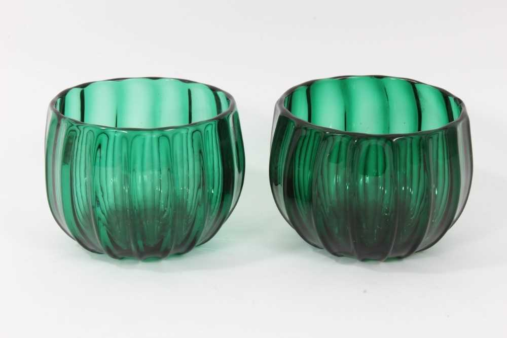 Lot 65 - Pair of green glass finger bowls, early 19th century, of moulded round shape with polished pontil marks, 9cm high