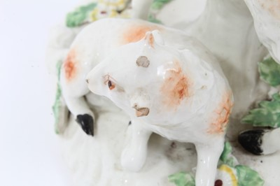 Lot 67 - Derby group of a sheep and a lamb, circa 1760, decorated in enamels, 13cm high