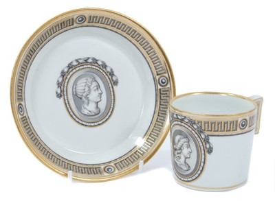 Lot 69 - Vienna coffee can and saucer, circa 1780, painted en grisaille with a portrait in profile, the edge with fret pattern, highlighted in gilt, underglaze blue marks to bases, the saucer measuring 13.5...
