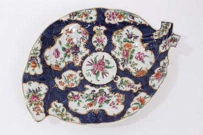 Lot 70 - Worcester cabbage leaf dish, circa 1770, painted with panels of flowers with gilt scrollwork borders, on a blue scale ground, seal mark to base, 26cm long