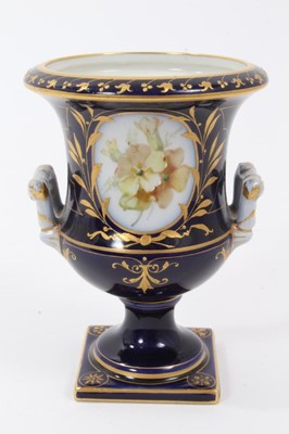 Lot 71 - Small Berlin porcelain campana vase, circa 1880, painted with flowers on a gilt and cobalt blue ground, marks to base, 9.75cm high