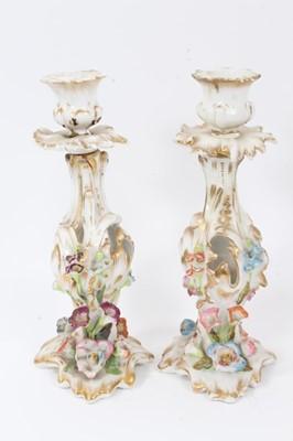 Lot 75 - Pair of Paris flower-encrusted candlesticks, circa 1860, with gilt scrollwork stems, 25cm tall