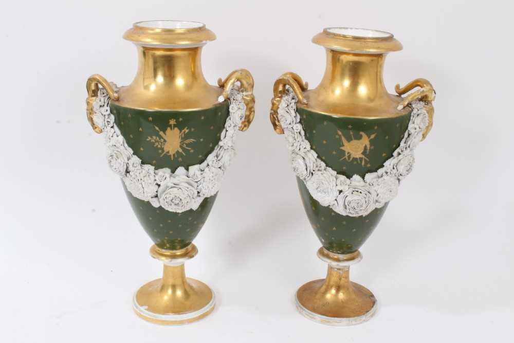 Lot 76 - Pair of Paris porcelain vases, 19th century, decorated with swags of encrusted flowers on a green and gilt ground, 29cm high