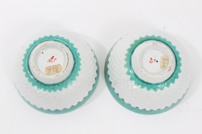 Lot 77 - Pair of unusual Bow tea bowls, circa 1770, with pineapple moulding, turquoise borders, and flower at the bottom, marks to base, 7.75cm diameter