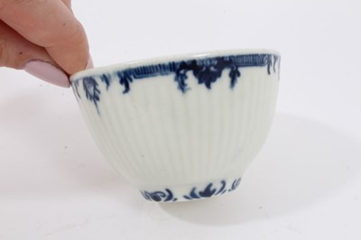 Lot 81 - Worcester blue and white fluted tea bowl and saucer, circa 1760, decorated with patterned borders, the saucer measuring 11.75cm diameter