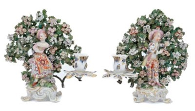 Lot 84 - Pair of Bow 'New Dancer' figure candlesticks, circa 1765, with bocage decoration behind each figure, standing on scrollwork bases, 24cm high