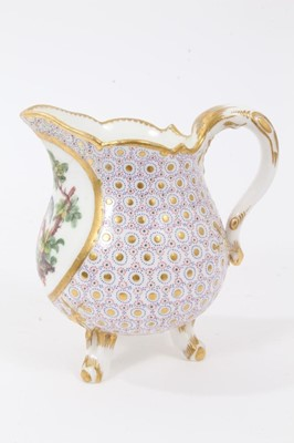 Lot 89 - Sèvres milk jug, circa 1770, probably painted by Evans, with scalloped rim and standing on three feet, the front decorated with a tropical bird, on a patterned ground, marks to base, 11.5cm high