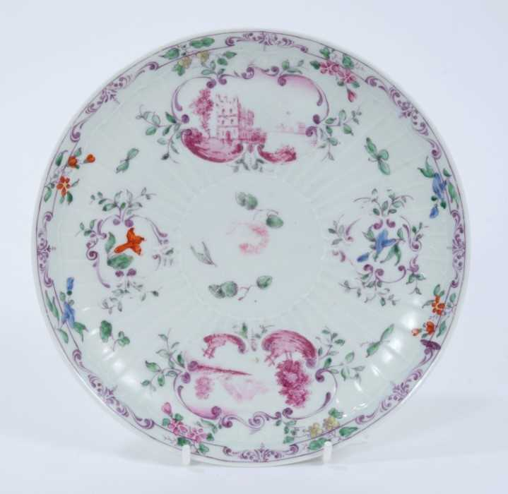 Lot 92 - Worcester pleat-moulded saucer dish, circa 1756-58, painted in the Meissen style with puce landscapes in scrollwork panels, flowers and foliate patterns, 18.5cm diameter