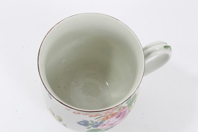 Lot 93 - Worcester mug, circa 1760, of small baluster form, polychrome painted in the Rogers style with flowers, 8.5cm high