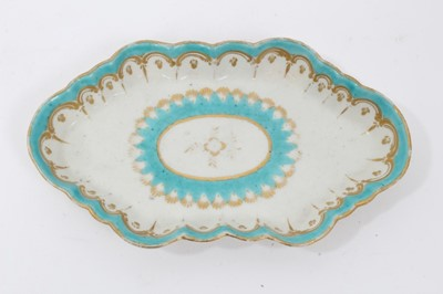 Lot 95 - Two 18th century Worcester items, including a spoon tray, of lozenge form, decorated in light blue and gilt, and a faceted tea bowl, polychrome painted with flowers