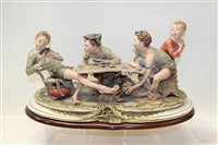 Lot 1082 - Large Capodimonte figure group of young card...