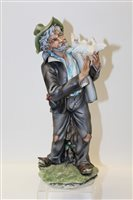 Lot 1088 - Capodimonte figure - Man with bird - with...