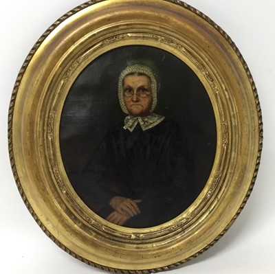 Lot 95 - English School, mid 19th century, oil on canvas, oval, portrait of an austere woman with glasses and white bonnet, 26 x 22cm, gilt frame